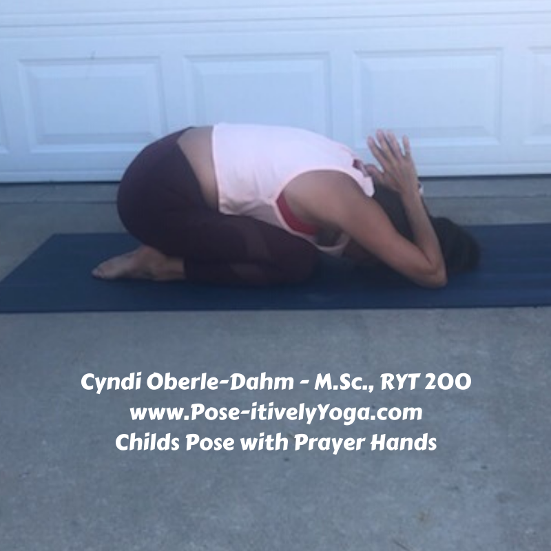 Childs Pose with Prayer Hands on Pose-itivelyYoga.com